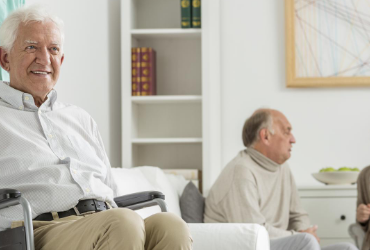 Residents sitting in a senior care facility